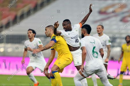 Al-Ahli's player Motaz Hawsawi (C) in action against Al-Nassr's Abderazak Hamdallah (2-L) during the Semi-finals of the King's Cup match between Al-Ahli and Al-Nassr at King Abdullah Sport City Stadium, 30 kilometers north of Jeddah, Saudi Arabia, 27 October 2020.