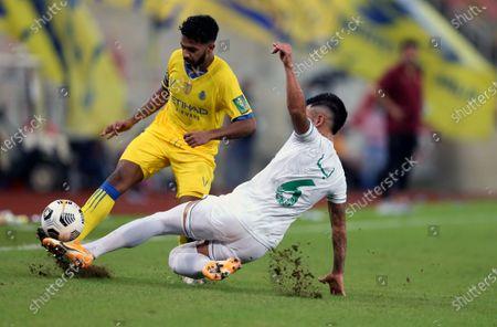 Al-Ahli's player Lucas Lima (R) in action against Al-Nassr's Khalid Al-Ghannam (L) during the Semi-finals of the King's Cup match between Al-Ahli and Al-Nassr at King Abdullah Sport City Stadium, 30 kilometers north of Jeddah, Saudi Arabia, 27 October 2020.