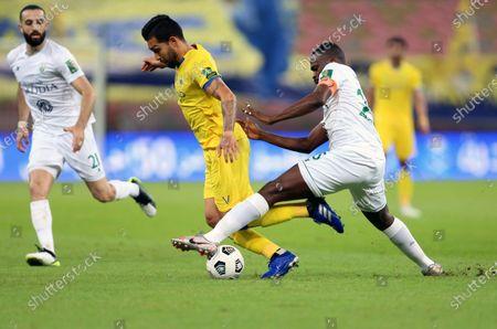 Al-Ahli's player Motaz Hawsawi (R) in action against Al-Nassr's Petros (L) during the Semi-finals of the King's Cup match between Al-Ahli and Al-Nassr at King Abdullah Sport City Stadium, 30 kilometers north of Jeddah, Saudi Arabia, 27 October 2020.