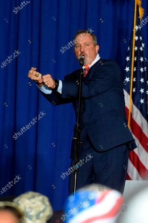 """Rep. Jeff Duncan of South Carolina gestures as he refers to President Donald Trump's """"home run"""" in the Supreme Court confirmation of Justice Amy Coney Barrett during a campaign rally featuring Vice President Mike Pence, in Greenville, S.C"""
