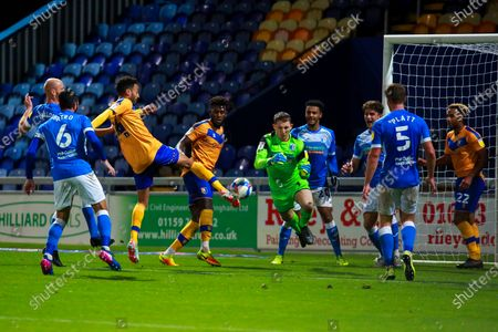James Perch of Mansfield Town shoots at goal to give his side their first goal of the game