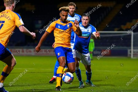 Stock Picture of Nicky Maynard of Mansfield Town on the ball under pressure from John Rooney of Barrow