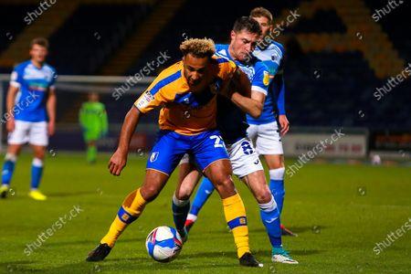 John Rooney of Barrow puts pressure on Nicky Maynard of Mansfield Town