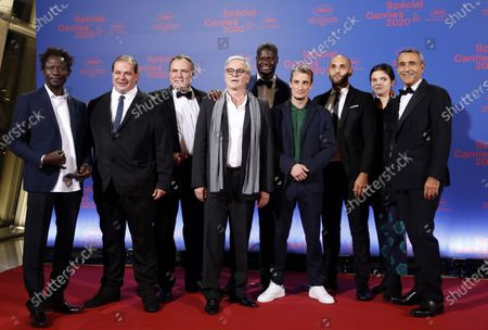 Emmanuel Courcol (C) poses with cast members of his film 'Un Triomphe' before the opening ceremony of the Cannes 2020 Special, in Cannes, France, 27 October 2020. The 73rd edition of the Cannes Film Festival which was to be held in May 2020 was canceled due to the Covid-19 pandemic. The Cannes 2020 Special runs from 27 to 29 October.