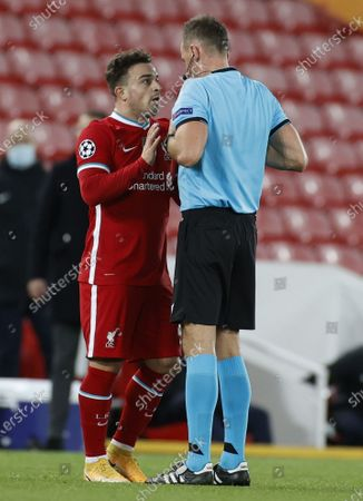 Liverpool's Xherdan Shaqiri  (L) argues with referee Pawel Raczkowsk during the UEFA Champions League group D match between Liverpool FC and Midtjylland in Liverpool, Britain, 27 October 2020.