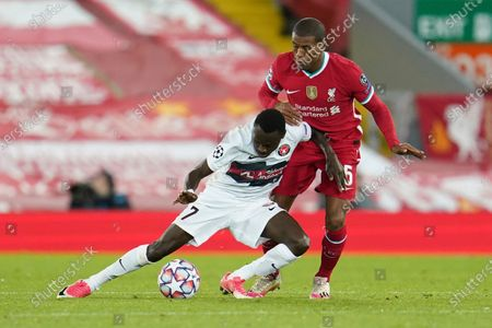 Midtjylland's Pione Sisto, left, competes for the ball with Liverpool's Georginio Wijnaldum during the Champions League Group D soccer match between Liverpool and FC Midtjylland at Anfield stadium, in Liverpool, England