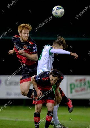 Cabinteely vs Drogheda United. Cabinteely's Aaron Byrne with Hugh Douglas and James Brown of Drogheda United