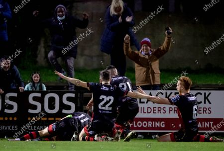 Stock Image of Cabinteely vs Drogheda United. Drogheda United's James Brown celebrates scoring a goal with team mates