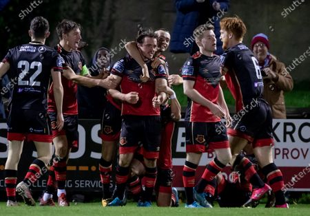 Stock Photo of Cabinteely vs Drogheda United. Drogheda United's James Brown celebrates scoring a goal with team mates
