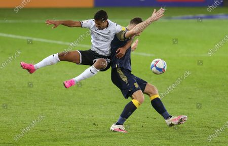 Kyle Naughton of Swansea City and Sam Vokes of Stoke City compete for the ball