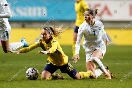 Sweden's Kosovare Asllani falling in ffront of Iceland's Sara Bjork Gunnarsdóttir during woman's European Championship soccer qualifying round group F at Old Ullevi Arena