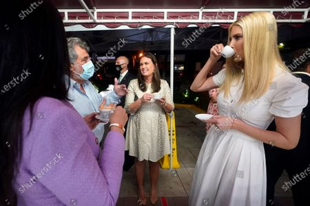 Ivanka Trump, right, shares a Cuban coffee with former White House press secretary Sarah Sanders, second from right, Felipe Valls Jr., second from left, owner of Versailles Cuban restaurant, and his daughter Nicole, left, in the Little Havana neighborhood in Miami, Fla