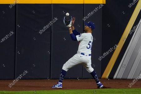 Los Angeles Dodgers shortstop Corey Seager fields a double off the way by Tampa Bay Rays' Kevin Kiermaier during the second inning in Game 6 of the baseball World Series, in Arlington, Texas