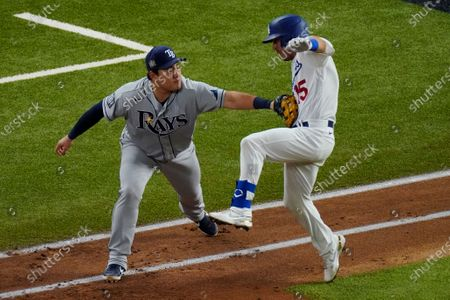 Tampa Bay Rays first baseman Ji-Man Choi tags out Los Angeles Dodgers' Austin Barnes during the third inning in Game 6 of the baseball World Series, in Arlington, Texas
