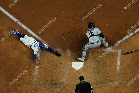Los Angeles Dodgers' Austin Barnes scores past Tampa Bay Rays catcher Mike Zunino during the sixth inning in Game 6 of the baseball World Series, in Arlington, Texas