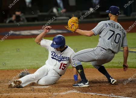 Los Angeles Dodgers' Austin Barnes scores past Tampa Bay Rays relief pitcher Nick Anderson on a wild pitch during the sixth inning in Game 6 of the baseball World Series, in Arlington, Texas