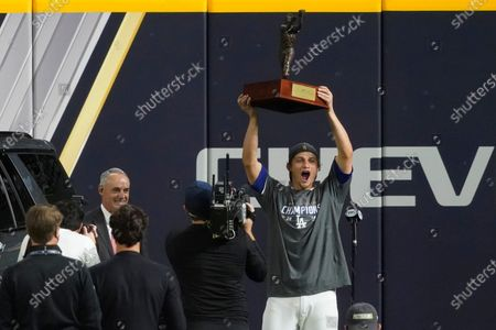 Los Angeles Dodgers shortstop Corey Seager holds up the MVP trophy after defeating the Tampa Bay Rays 3-1 to win the baseball World Series in Game 6, in Arlington, Texas