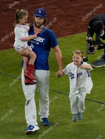 Stock Photo of Los Angeles Dodgers pitcher Clayton Kershaw celebrates with his family after defeating the Tampa Bay Rays 3-1 to win the baseball World Series in Game 6, in Arlington, Texas