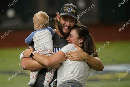 Stock Picture of Los Angeles Dodgers starting pitcher Clayton Kershaw celebrates with family after defeating the Tampa Bay Rays 3-1 to win the baseball World Series in Game 6, in Arlington, Texas