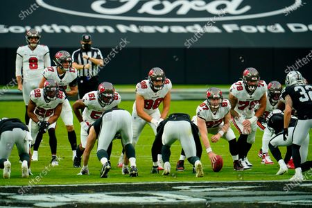 Stock Image of Tampa Bay Buccaneers punter Bradley Pinion (8) stands behind his offensive line including defensive back Andrew Adams (26), linebacker Kevin Minter (51), linebacker Anthony Nelson (98), long snapper Zach Triner (97) and defensive end Pat O'Connor (79) as they face the Las Vegas Raiders special teams during the first half of an NFL football game, in Las Vegas