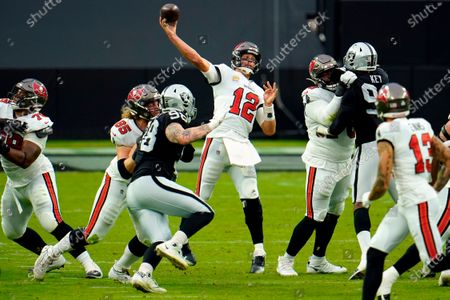 Tampa Bay Buccaneers quarterback Tom Brady (12) throws a pass to Tampa Bay Buccaneers wide receiver Scott Miller (10) against the Las Vegas Raiders during the first half of an NFL football game, in Las Vegas