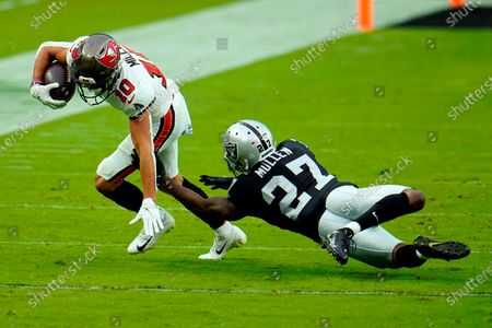 Tampa Bay Buccaneers wide receiver Scott Miller (10) avoids a tackle from Las Vegas Raiders cornerback Trayvon Mullen (27) during the first half of an NFL football game, in Las Vegas