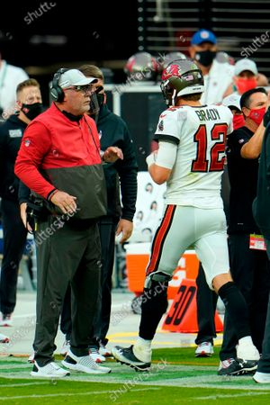 Tampa Bay Buccaneers quarterback Tom Brady (12) celebrates with head coach Bruce Arians after throwing a touchdown to wide receiver Scott Miller (10) against the Las Vegas Raiders during the first half of an NFL football game, in Las Vegas