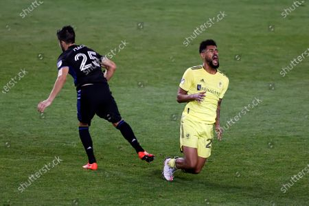 Nashville SC midfielder Anibal Godoy (20) reacts after being fouled by Montreal Impact midfielder Emanuel Maciel (25) during the second half of an MLS soccer match, in Harrison, N.J. Nashville SC defeated the Montreal Impact 1-0