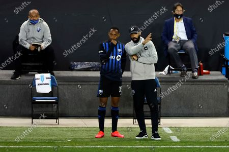 Montreal Impact head coach Thierry Henry directs Mason Toye (13) against the Nashville SC during the second half of an MLS soccer match, in Harrison, N.J. Nashville SC defeated the Montreal Impact 1-0