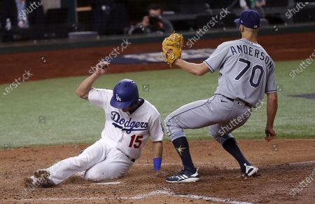 Los Angeles Dodgers baserunner Austin Barnes scores in front of Tampa Bay Rays pitcher Nick Anderson (R) on a wild pitch in the bottom of the sixth inning of Major League Baseball's World Series Game six at Globe Life Field in Arlington, Texas, USA, 27 October 2020. The Dodgers lead the best-of-seven series 3-2.