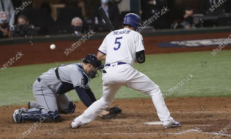 Stock Picture of A wild pitch gets past Tampa Bay Rays catcher Mike Zunino (L) on a wild pitch by Nick Anderson as Los Angeles Dodgers batter Corey Seager batted, allowing the game-tying run to score  in the bottom of the sixth inning of Major League Baseball's World Series Game six at Globe Life Field in Arlington, Texas, USA, 27 October 2020. The Dodgers lead the best-of-seven series 3-2.