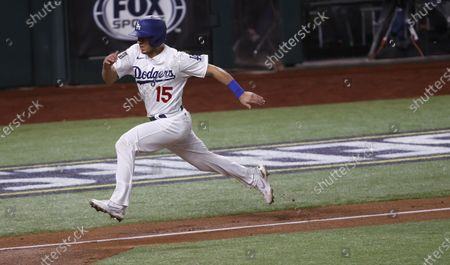 Los Angeles Dodgers baserunner Austin Barnes runs home to score on a wild pitch by the Tampa Bay Rays in the bottom of the sixth inning of Major League Baseball's World Series Game six at Globe Life Field in Arlington, Texas, USA, 27 October 2020. The Dodgers lead the best-of-seven series 3-2.