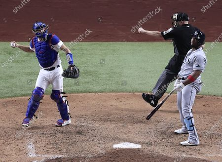 Home plate umpire Jerry Meals (C) calls out Tampa Bay Rays pinch hitter Yandy Diaz (R) for an innin-ending strikout as Los Angeles Dodgers catcher Austin Barnes (L) reacts in the bottom of the seventh inning of Major League Baseball's World Series Game six at Globe Life Field in Arlington, Texas, USA, 27 October 2020. The Dodgers lead the best-of-seven series 3-2.