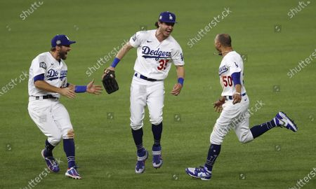 Stock Picture of Los Angeles Dodgers players (L-R) Chris Taylor, Cody Bellinger and Mookie Betts celebrate after defeating the Tampa Bay Rays in Major League Baseball's World Series Game six to win the World Series at Globe Life Field in Arlington, Texas, USA, 27 October 2020. The Dodgers win the best-of-seven series 4-2.