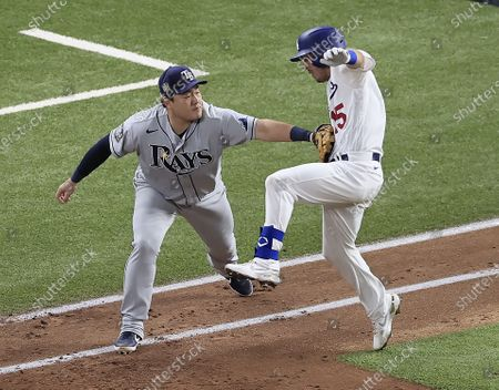 Tampa Bay Rays first baseman Ji-Man Choi tags out Los Angeles Dodgers batter Austin Barnes (R) on a groundout after the throw to Choi drew him off the bag in the bottom of the third ining of Major League Baseball's World Series Game six at Globe Life Field in Arlington, Texas, USA, 27 October 2020. The Dodgers lead the best-of-seven series 3-2.