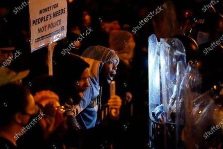Protesters confront police during a march, in Philadelphia. Hundreds of demonstrators marched in West Philadelphia over the death of Walter Wallace, a Black man who was killed by police in Philadelphia on Monday. Police shot and killed the 27-year-old on a Philadelphia street after yelling at him to drop his knife
