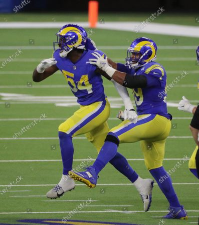 Los Angeles Rams defensive end Aaron Donald (99) celebrates with Los Angeles Rams outside linebacker Leonard Floyd (54) and Floyd sacked Chicago Bears quarterback Nick Foles (9) in the first half at So-Fi Stadium on October 26, 2020 in Inglewood, California. (Gina Ferazzi / Los Angeles Times)