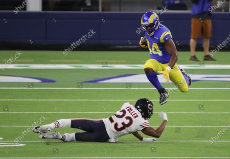 Los Angeles Rams running back Malcolm Brown (34) leaps over Chicago Bears cornerback Kyle Fuller (23) fro extra yardage in the first half at So-Fi Stadium on October 26, 2020 in Inglewood, California. (Gina Ferazzi / Los Angeles Times)