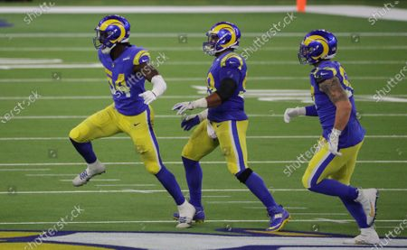 Los Angeles Rams outside linebacker Leonard Floyd (54), left, celebrates his sack of Chicago Bears quarterback Nick Foles (9) with Los Angeles Rams defensive end Aaron Donald (99) and Los Angeles Rams defensive end Morgan Fox (97) in the first half at So-Fi Stadium on October 26, 2020 in Inglewood, California. (Gina Ferazzi / Los Angeles Times)