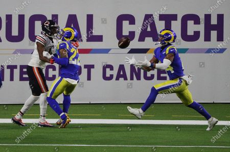 Los Angeles Rams cornerback Troy Hill (22) tips a pass intended for Chicago Bears wide receiver Darnell Mooney (11) as Los Angeles Rams safety Taylor Rapp (24) comes into make the interception in the end zone in the second half at So-Fi Stadium on October 26, 2020 in Inglewood, California. (Gina Ferazzi / Los Angeles Times)