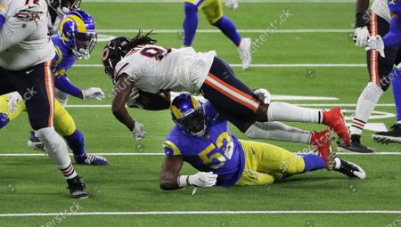 Los Angeles Rams linebacker Terrell Lewis (52) stops Chicago Bears wide receiver Cordarrelle Patterson (84) short of a first down on a 4th and 1 play in the second half at So-Fi Stadium on October 26, 2020 in Inglewood, California. (Gina Ferazzi / Los Angeles Times)