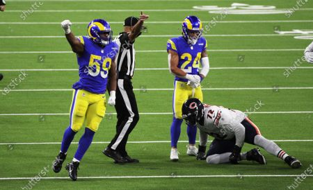 Los Angeles Rams middle linebacker Micah Kiser (59) and Los Angeles Rams safety Taylor Rapp (24) react after stopping Chicago Bears offensive tackle Charles Leno Jr. (72) short of a first down on a 4th and 1 play in the second half at So-Fi Stadium on October 26, 2020 in Inglewood, California. (Gina Ferazzi / Los Angeles Times)