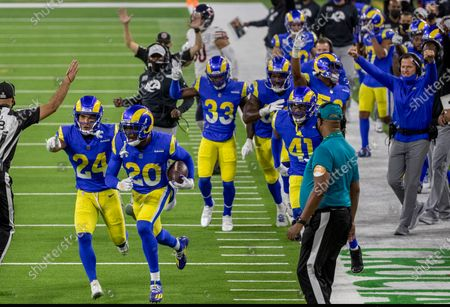 Los Angeles Rams cornerback Jalen Ramsey (20) with Los Angeles Rams safety Taylor Rapp (24) lead the celebration after Ramsey intercepted a pass intended for Chicago Bears tight end Jimmy Graham (80) in the 4th quarter at So-Fi Stadium on October 26, 2020 in Inglewood, California. (Gina Ferazzi / Los Angeles Times)