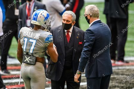 Atlanta Falcons Owner Arthur Blank talks with Detroit Lions wide receiver Marvin Hall (17) and President and CEO Ron Wood before an NFL football game, in Atlanta. The Detroit Lions won 23-22