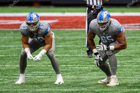 Detroit Lions offensive tackle Tyrell Crosby (65) and tight end Jesse James (83) line up during the first half of an NFL football game against the Atlanta Falcons, in Atlanta. The Detroit Lions won 23-22