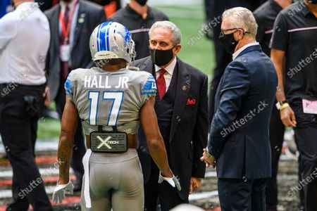 Stock Photo of Atlanta Falcons Owner Arthur Blank talks with Detroit Lions wide receiver Marvin Hall (17) and President and CEO Ron Wood before an NFL football game, in Atlanta. The Detroit Lions won 23-22