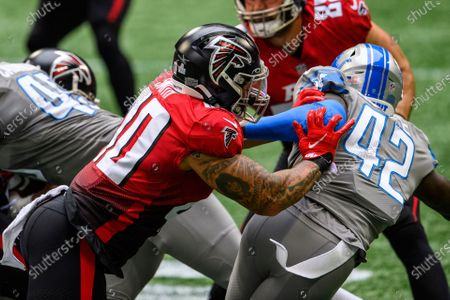 Atlanta Falcons fullback Keith Smith (40) blocks Detroit Lions safety Jayron Kearse (42) during the first half of an NFL football game, in Atlanta. The Detroit Lions won 23-22