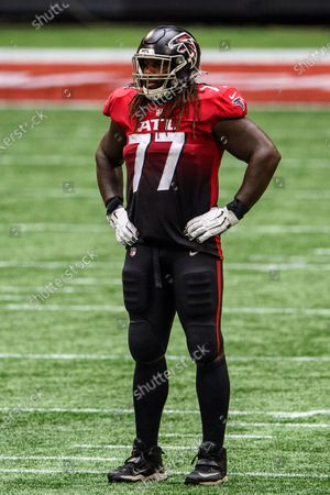 Atlanta Falcons offensive guard James Carpenter (77) stands during the second half of an NFL football game against the Detroit Lions, in Atlanta. The Detroit Lions won 23-22