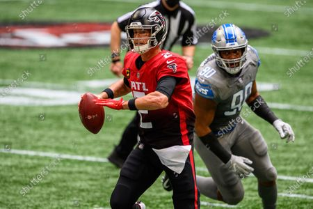 Atlanta Falcons quarterback Matt Ryan (2) evades Detroit Lions defensive end Trey Flowers (90) during the first half of an NFL football game, in Atlanta. The Detroit Lions won 23-22