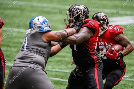 Atlanta Falcons offensive guard James Carpenter (77) blocks Detroit Lions nose tackle Danny Shelton (71) during the first half of an NFL football game, in Atlanta. The Detroit Lions won 23-22